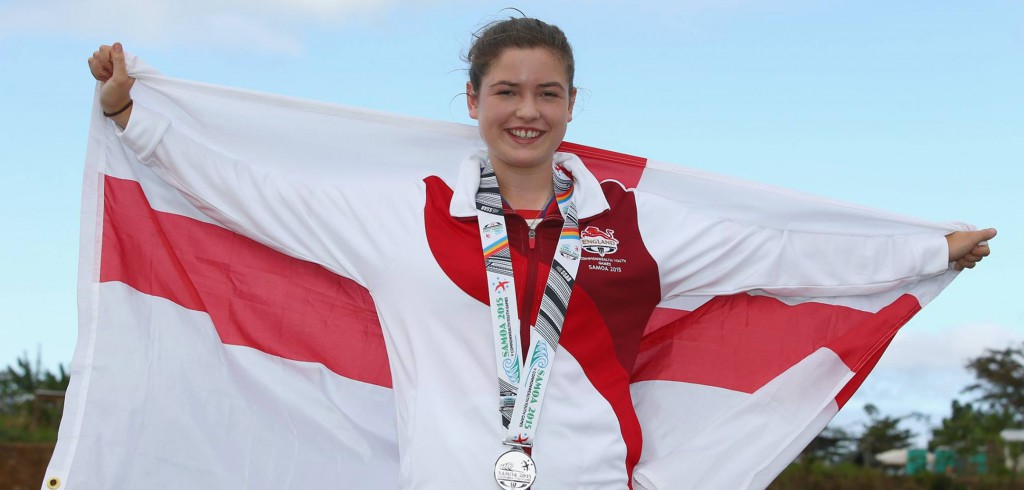 Lizzie Warner shows off her Commonwealth Youth Games silver medal